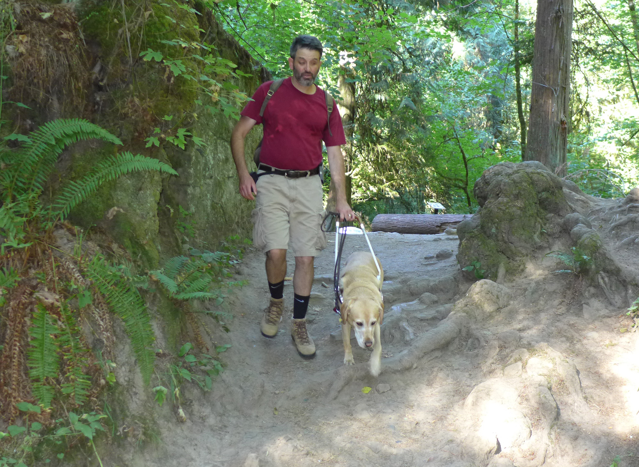 Alex Schay and Clifton on Wildwood Trail. Photo: Wesley Mahan, NW Examiner
