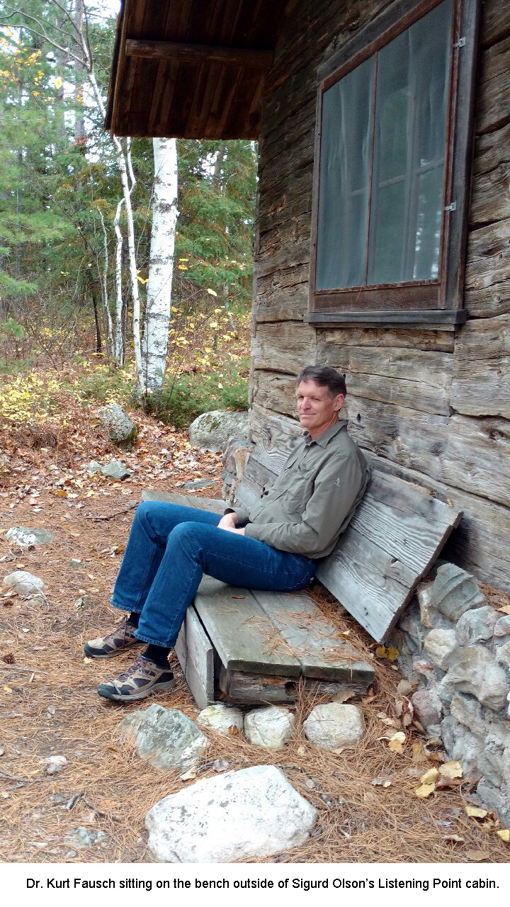 Kurt Fausch on the bench at the Listening Point cabin