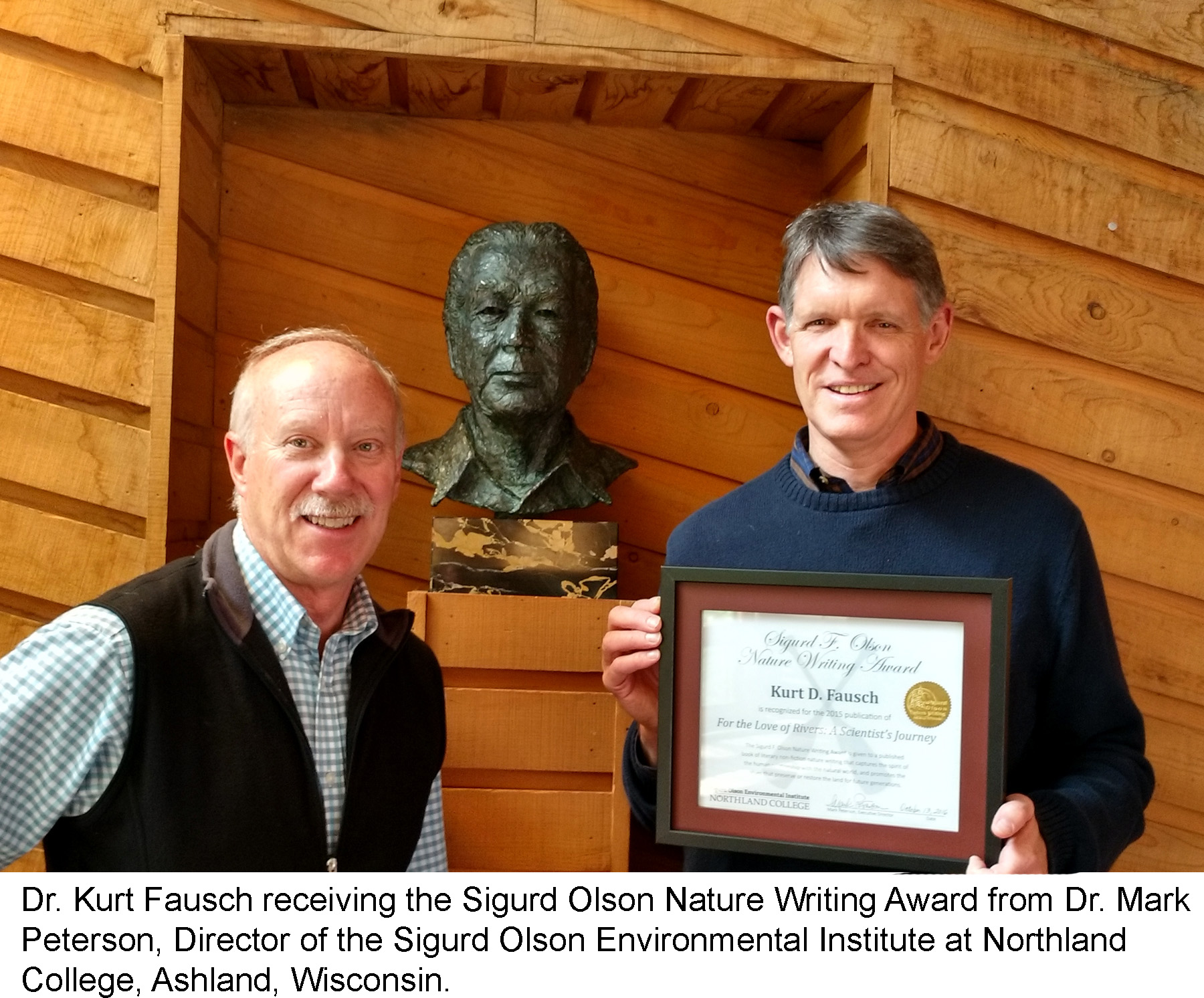 Dr. Kurt Fausch receiving the Sigurd Olson Nature Writing Award from Dr. Mark Peterson, Director of the Sigurd Olson Environmental Institute at Northland College, Ashland, Wisconsin