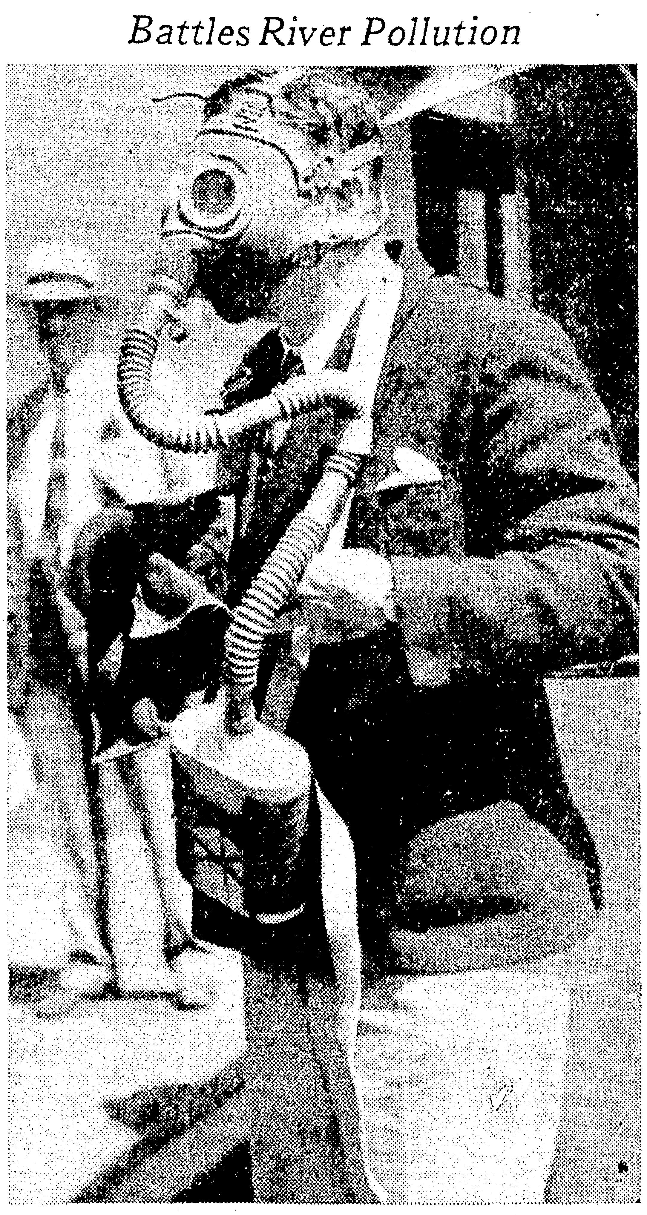 "Will R. Lewis, ""foe of filth,"" dons a gas mask along the banks of the Willamette as a member of the City of Portland's sewage committee touring Portland Harbor in August 1936 (Morning Oregonian, Aug. 5, 1936, sec. 1, p. 3)."
